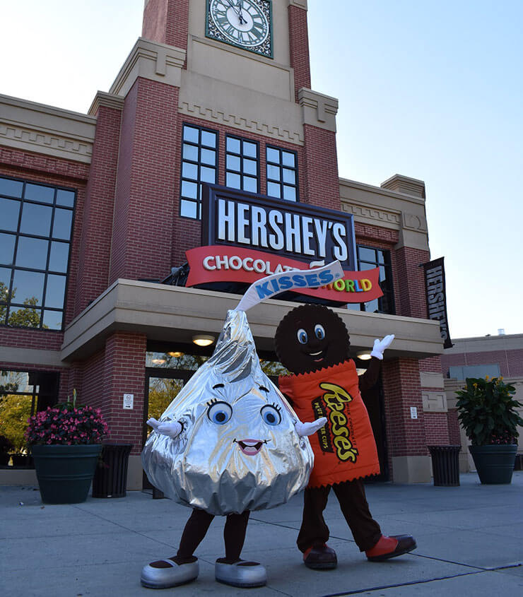 Family taking a selfie outside Hershey's Chocolate World