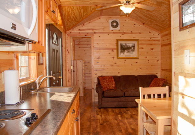 Interior view of Cabin Living room at Hersheypark Camping Resort