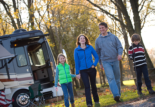 Family walking from their RV at Hersheypark Camping resort in the Fall