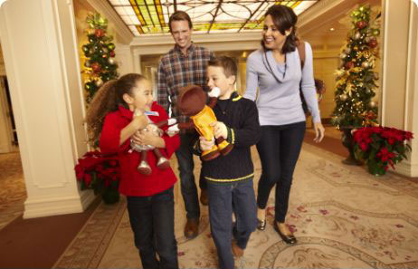 Family walking in the lobby at the hotel hershey during the holiday season