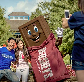 family taking a photo with the Hershey Bar character