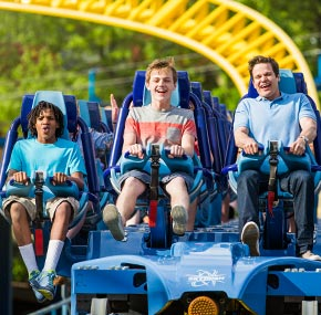 people riding the skyrush roller coaster