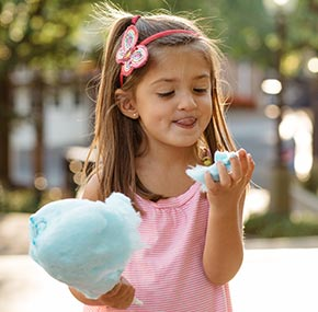girl enjoying cotton candy