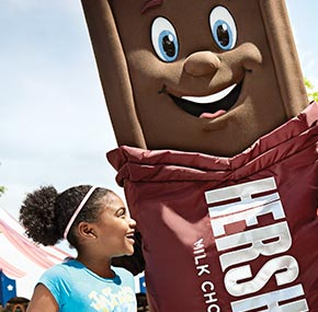 girl having fun with the Hershey Bar character