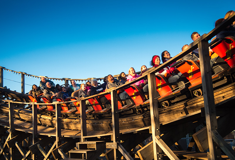 People riding Wildcat Wooden Coaster