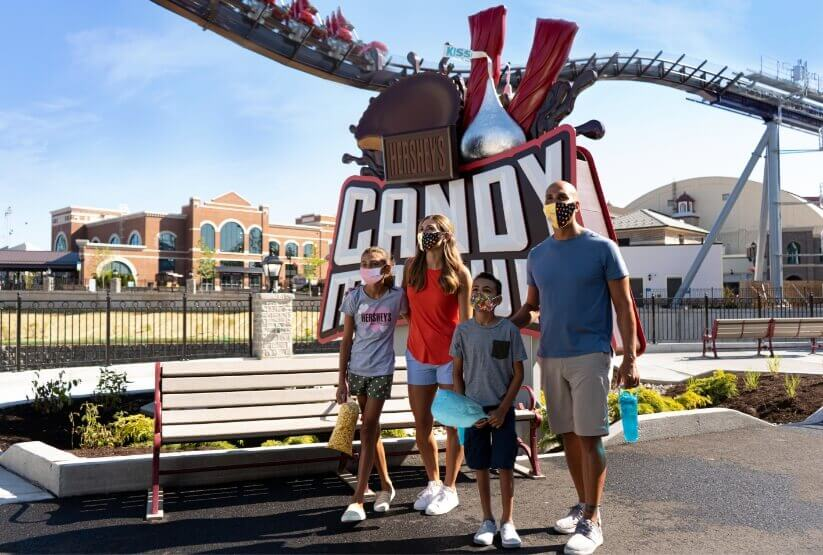 family at the candymonium sign hersheypark