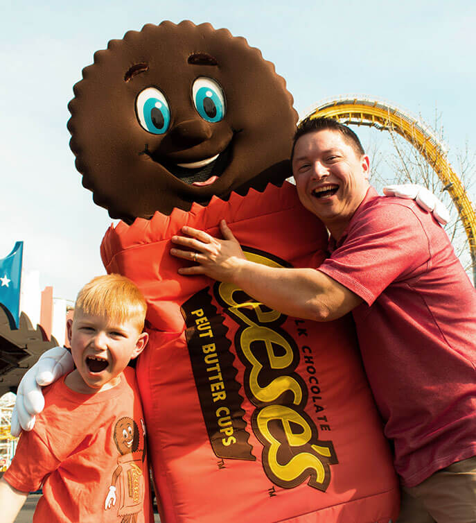a Dad, the Reeses character, and kid