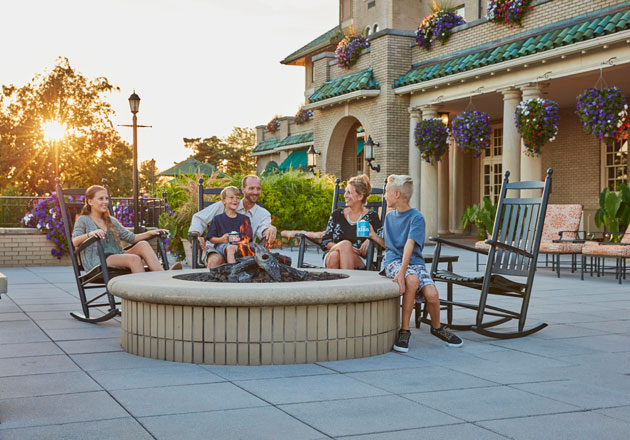 Family enjoying the outdoor firepit at The Hotel Hershey